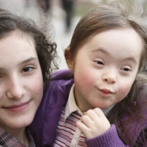2 sisters, one with Downs Syndrome
