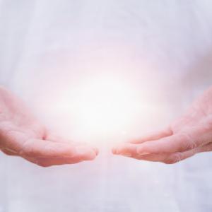 Hands emitting light energy